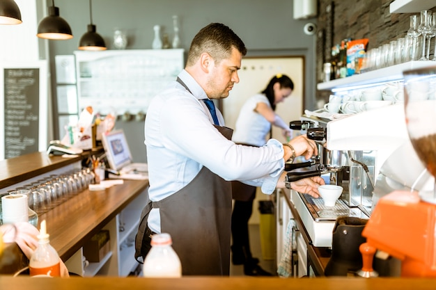 Barman making coffee Free Photo