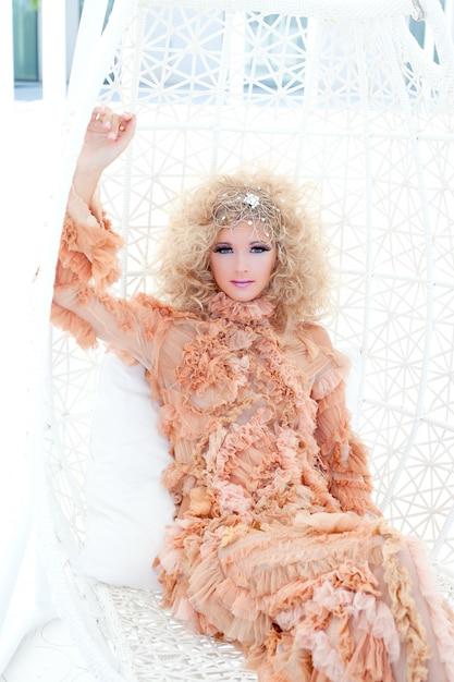 Baroque haute couture woman portrait with vampire inspiration in hammock Premium Photo