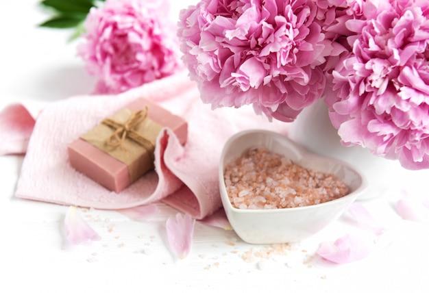 Bars of handmade soap,  soft towels and peony flowers Premium Photo