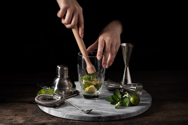 Bartender equipment shaker strainer jigger on wood background with copy space Premium Photo