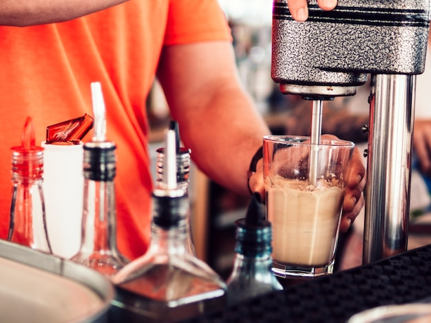 Bartender mixing tasty drink Free Photo
