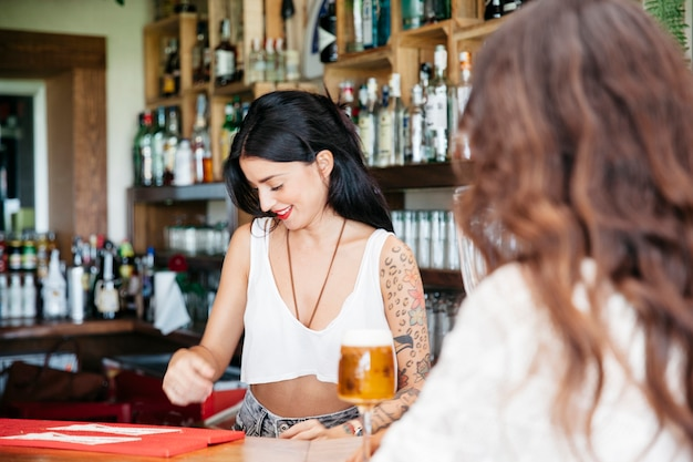 Bartender and woman with beer Free Photo