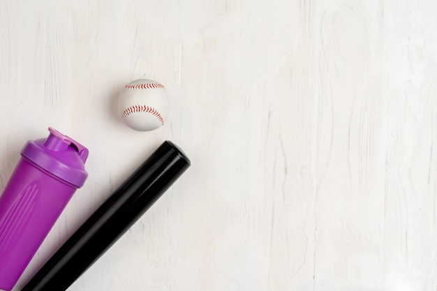 Baseball bat and ball, view from above Premium Photo