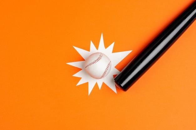 Baseball bat and ball, view from above Premium Photo