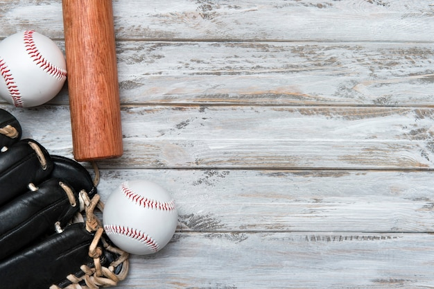 Baseball bat, glove and ball on wooden backgound Premium Photo