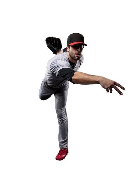Baseball player in red uniform,. Premium Photo