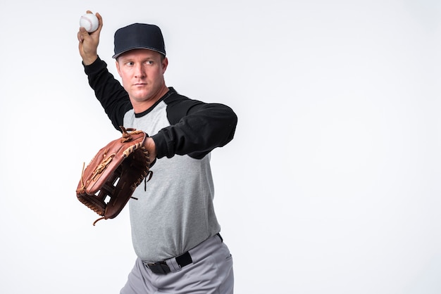 Baseball player throwing ball Premium Photo