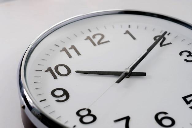 Basic clock on white background Premium Photo