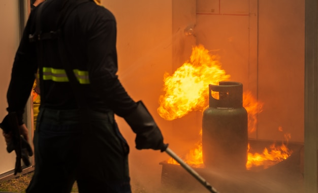 Basic fire fighting and evacuation fire drill training for safety in condominium Premium Photo