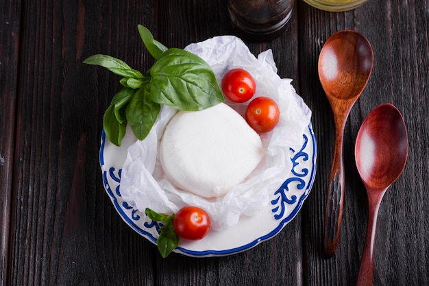Basil leaves and mozzarella on a plate Free Photo