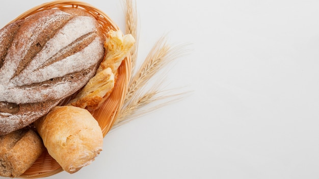 Basked of bread with wheat Free Photo