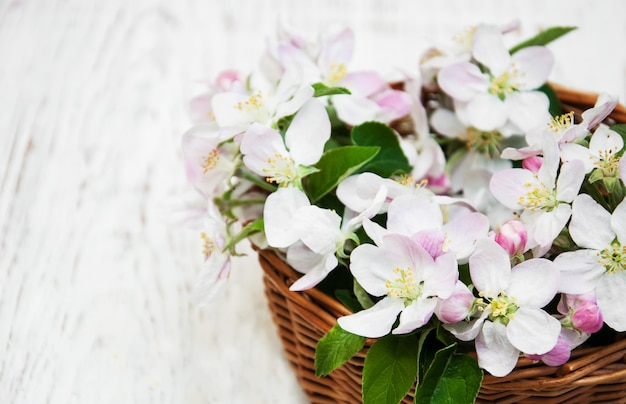 Basket with apple blossoms Premium Photo