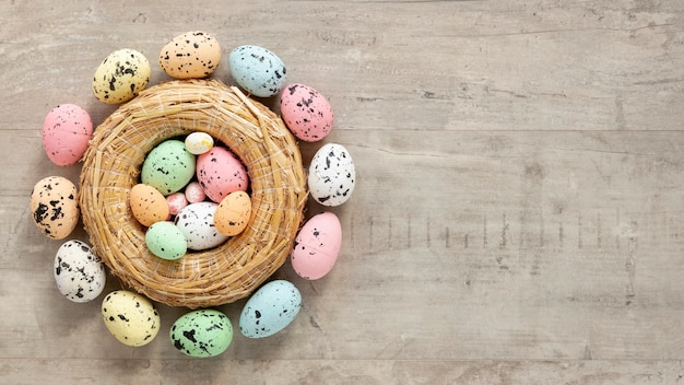 Basket with colorful painted eggs for easter Free Photo