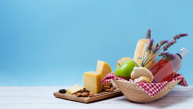 Basket with goodies and lavender with blue background Free Photo