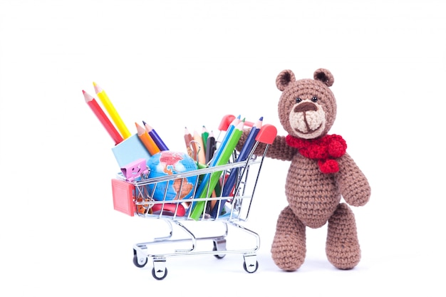 Basket with pensils and teddy bear Premium Photo