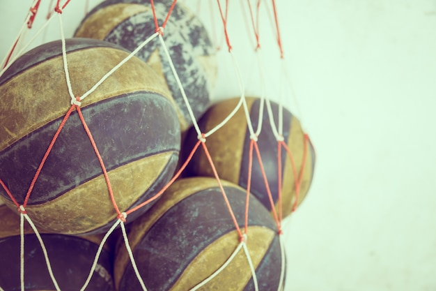 Basketball balls in a net Free Photo
