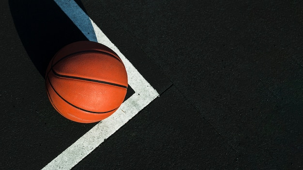 Basketball on court with copy space Free Photo