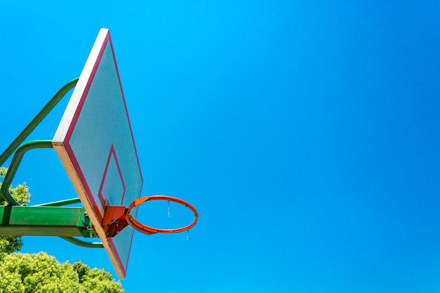 basketball hoop and backboard with blue sky Free Photo