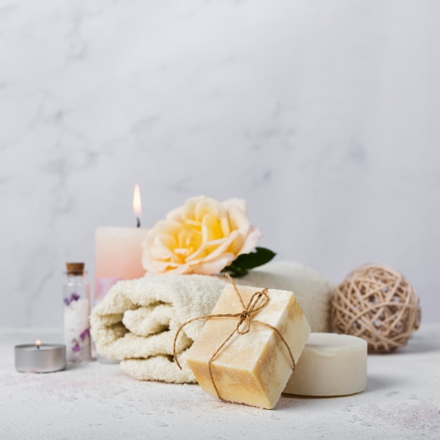 Bath arrangement with soap and towel Free Photo