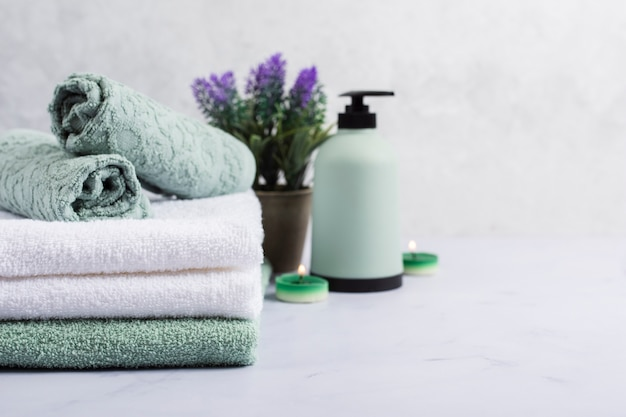 Bath concept with towels and lilac Free Photo