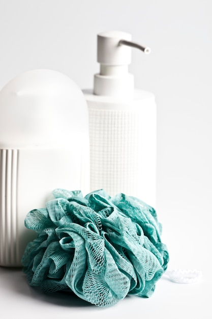 Bath cosmetic products and green sponge on light Premium Photo