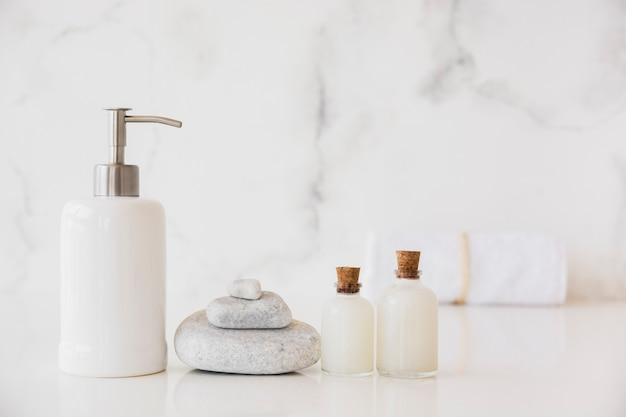 Bath products on table with marble background and copy space Free Photo