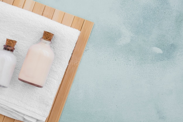 Bath products on towel with copy space Free Photo