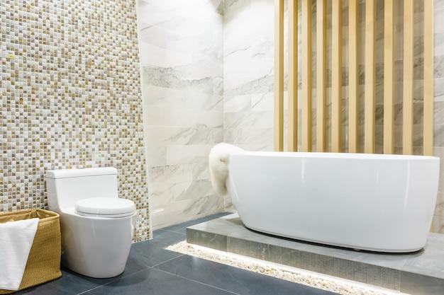 Bathroom interior with minimalistic shower, white toilet, sink and bathtub Premium Photo