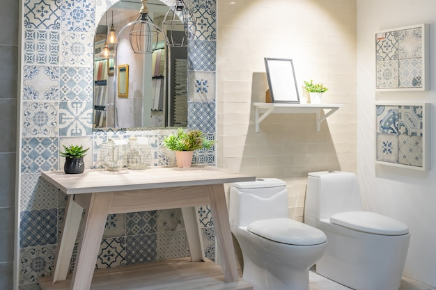 Bathroom interior with white wall, vintage furniture, towels, toilet and sink Premium Photo