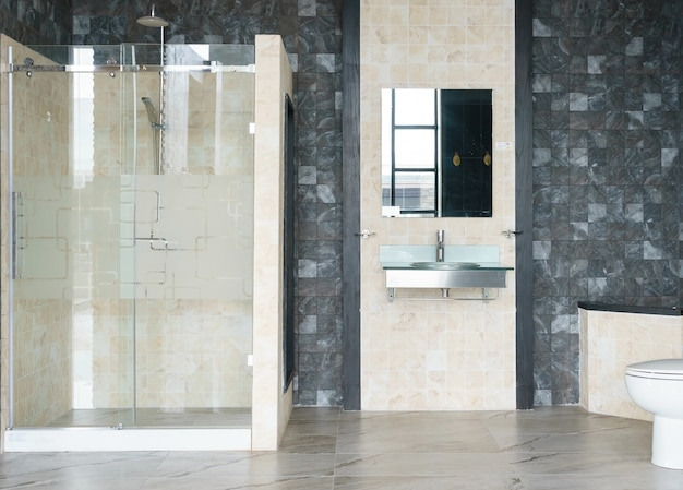 Bathroom interior with white walls, a shower cabin with glass wall Premium Photo