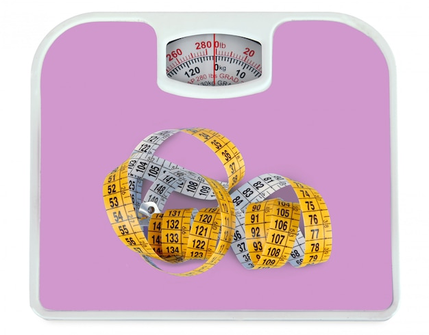 Bathroom scale with a measuring tape Premium Photo