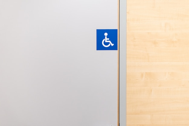 Bathroom sign for disabled people in a store. Premium Photo