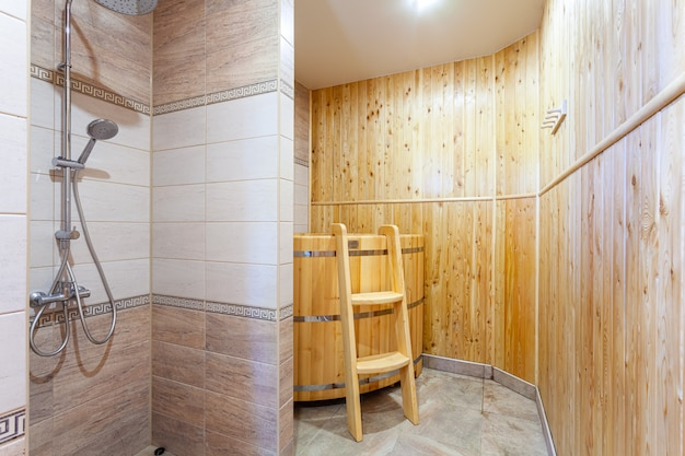 Bathroom in a traditional style with brown and beige walls. minimalist shower room with hotel sauna Premium Photo