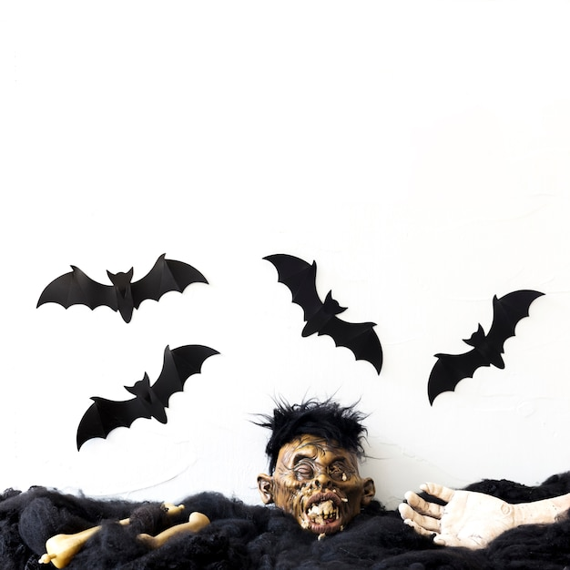 Bats flying over dead body parts Free Photo
