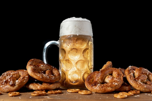 Bavarian beer surrounded with pretzels Free Photo