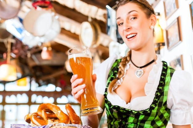 Bavarian woman drinking wheat beer Premium Photo