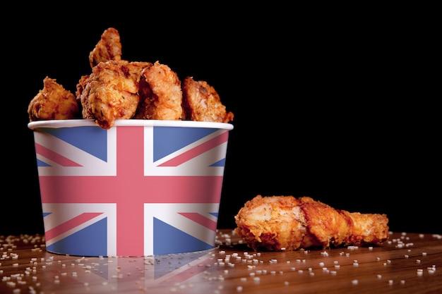 Bbq chicken legs in white bucket Premium Photo