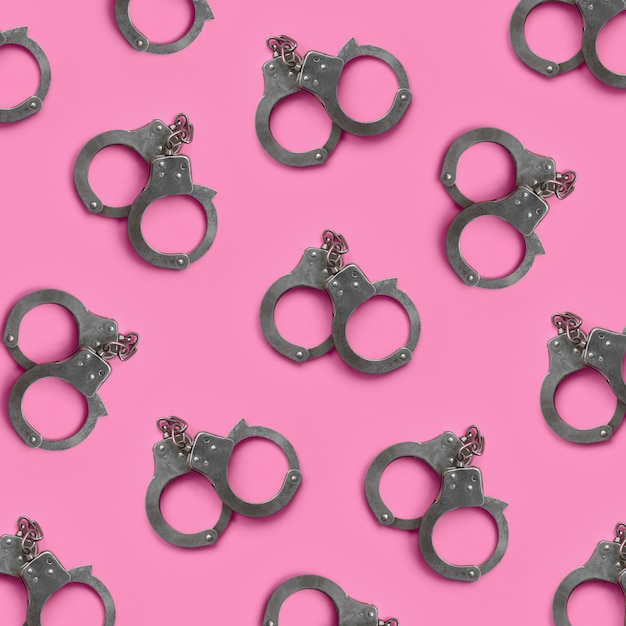Bdsm and sex games concept. many handcuffs on pink Premium Photo