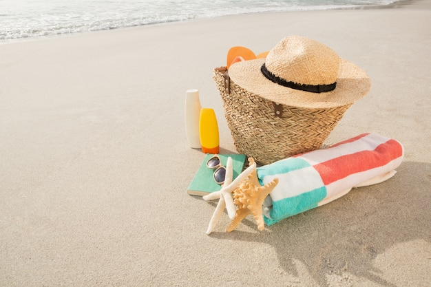 Beach accessories on sand Free Photo