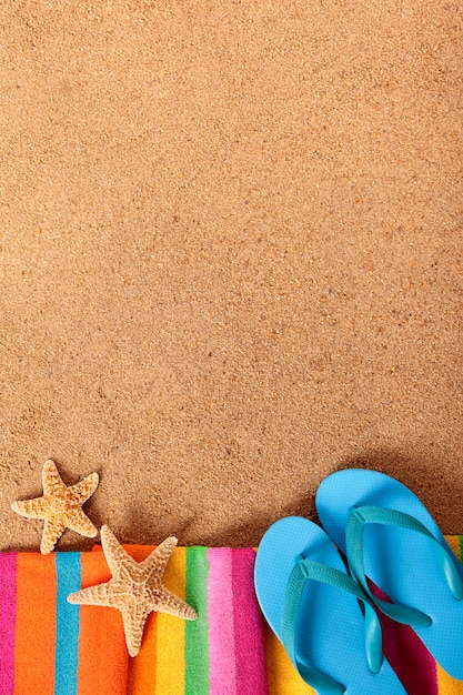 6fb980694 Beach background with flip flops Free Photo