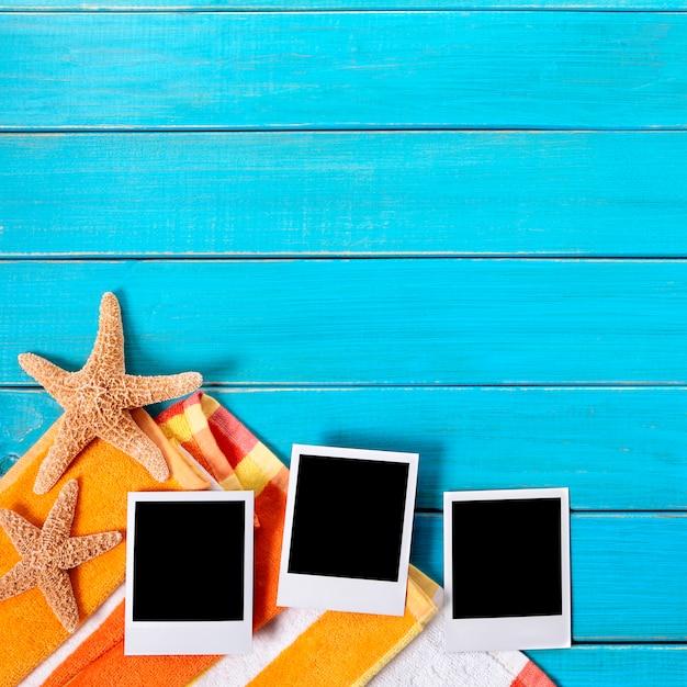 Beach background with three blank polaroid photo prints, copy space Premium Photo