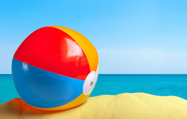 Beach ball on a white sandy Premium Photo
