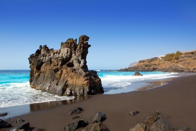 Beach el bollullo black brown sand and aqua water Premium Photo