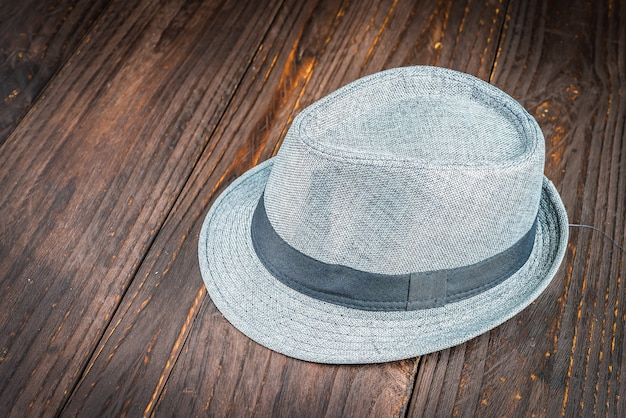 Beach hat on wooden background Free Photo