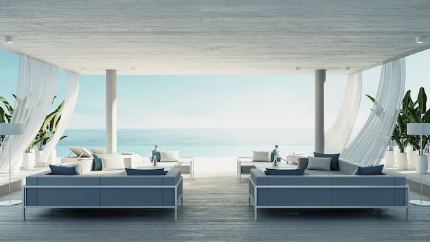 Beach living lounge - ocean villa seaside & sea view for vacation and summer / 3d render interior Premium Photo