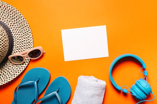 Beach marine items and sheet of paper on bright background Free Photo