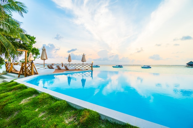 Beach palm blue sky infinity Free Photo