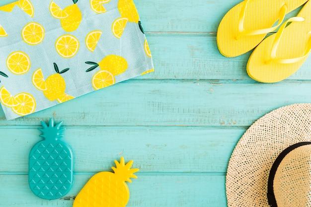 Beach resort items on blue background Free Photo