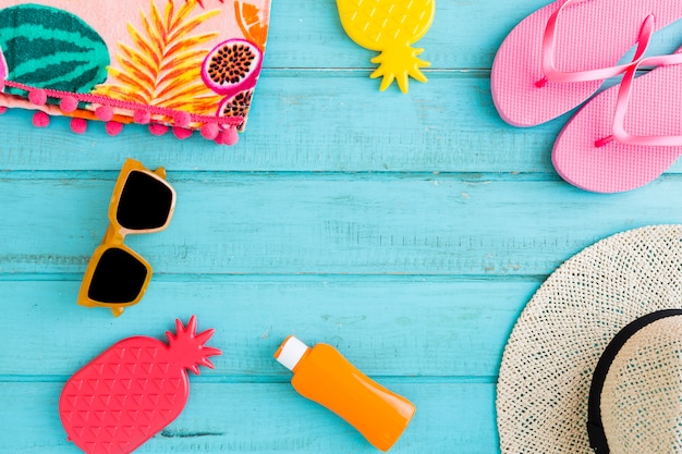 Beach vacation things on blue background Free Photo