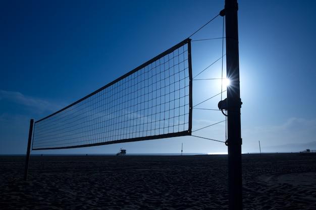Beach voley net in santa monica at sunset california Premium Photo